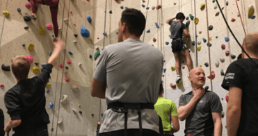 3DHubs team members in an indoor climbing gym