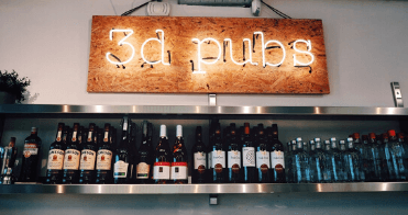 The 3D Pubs sign above our office alcohol selection at our in-house bar